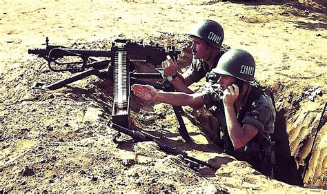 Two swedish UN soldiers with a machine gun during the