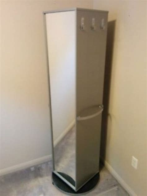 IKEA rotating cabinet mirror storage unit in NW1 London