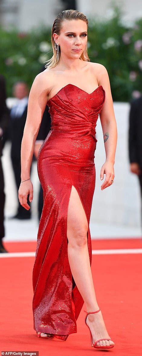 Scarlett Johansson puts on a VERY leggy display in a red