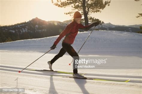 Young Woman Crosscountry Skiing Profile High-Res Stock